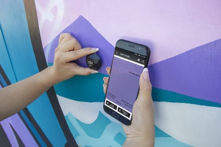Photo shows Nix Sensor measuring the current paint color on a wall.