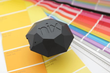 Photo shows Nix sensor to measure the color in a printed swatch book.