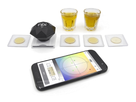 Photo shows Nix Sensor being used to measure the color of liquids.